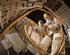 """Edward H. White II became the first American to perform a spacewalk on June 3, 1965. He floated outside the Gemini IV capsule for 20 minutes, remaining connected to the spacecraft's life-support and communications systems by a golden """"umbilical cord"""" and using a hand-held jet thruster to maneuver in space. Shown here is Ed White's spacesuit as it was formerly displayed inside the Gemini IV capsule. The capsule is on display in the Boeing #MilestonesofFlight Hall at the Museum in Washington…"""