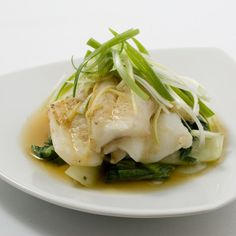 This fish is steamed on plates, which hold the marinade and juices around the fillets. Be sure that the plates you use have enough of a rim to hold some liquid, and are not larger in diameter than the pan you'll be using to steam.                   In order to fit the plate on top of the steamer, you'll need a steamer basket that's flat all the way across, without a central protrusion. Many Asian bamboo and stainless-steel steamers have this shape but, if you don't have one, you can…