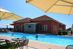 Best Kefalonia hotels: 2 bedroom Skala apartments - green lawn with beautiful sea view, swimming pool, bar. Book and enjoy! Cozy Bar, Secluded Beach, Greece Vacation, Green Lawn, 2 Bedroom Apartment, Small Boats, Bungalow, Swimming Pools, Island