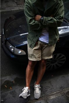 Shop this look for $121: http://lookastic.com/men/looks/olive-jacket-and-white-crew-neck-t-shirt-and-beige-shorts-and-grey-low-top-sneakers/26 — Olive Jacket — White Crew-neck T-shirt — Beige Shorts — Grey Low Top Sneakers