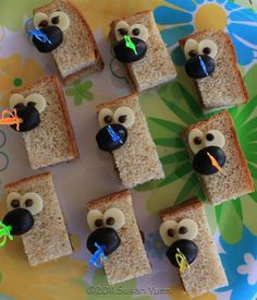 Ferb sammies-cheese and chocolate chip eyes and olive/grape nose (just PBJ inside)! :)