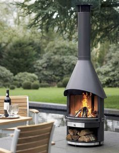 A black-varnished stainless steel Garden Fireplace with a double-sided hood and a wide opening. Chiminea Fire Pit, Fire Pit Backyard, Fire Pits, Fireplace Garden, Fireplace Design, Outdoor Rooms, Outdoor Living, Outdoor Decor, Cast Iron Fire Pit