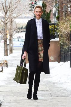 Karlie Kloss gave off preppy vibes thanks to a crisp, white button down tucked into a plaid-printed skirt. ...