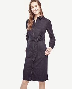 """Impeccably tailored in a classic silhouette, our rich denim is best dressed. Point collar. Long sleeves with button closure. Button front. Self tie belt. Front patch pockets. Side slits. 23"""" from natural waist."""