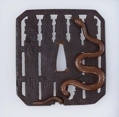 Tsuba with design of grave-posts and snake   Museum of Fine Arts, Boston