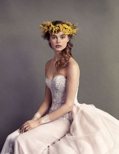 Strapless gown with silk tulle and organza with petal-pink underlay and beaded-lace appliqués, $6,820, and detachable train, $6,160, both by Ines Di Santo, at Bergdorf Goodman Bridal Salon.