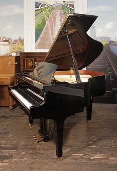 "A 2008, Boston GP156 baby grand piano for sale with a black case and spade legs £12,000. Piano has an eighty-eight note keyboard and a three-pedal lyre. Price includes a 3 year warranty, First tuning free. Usually 4 weeks after piano delivery to allow ""settling in"", Free piano stool and free   delivery to a ground floor residence within mainland UK."