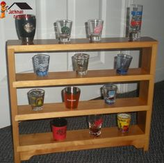 Small shelves made for holding a shot glass collection