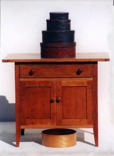 Sewing case, maple and cherry, breadboard top, over single drawer over two-door cupboard, on canted square legs, original varnish finish, Hancock, MA, c. 1840, (ex. Belfit collection).