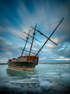 """Jordan Harbour Shipwreck"" It began life as a not even close replica of the ""Grand Hermie"" used by Jacques Cartier in 1535-1536 and 1541-1542 to explore Canada. It was built in 1967 and was supposedly used as a shipboard casino in Quebec until being moved to it's current location to be used as a restaurant. That never happened, Now it sits, burnt, rusted and abandoned, propped up by steel supports inside the shallow end of the harbor. Photo by Jim Johnston. Source Flickr.com"