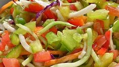 This easy-to-prepare slaw recipe is a little different from the rest. A tangy vinaigrette dressing is simmered and poured over cabbage, cucumbers, and tomatoes for a refreshing slaw that is perfect for picnics.