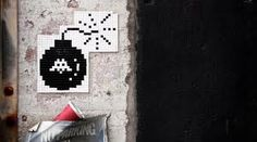 street art colored space invader bomb