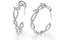 Fei Liu: Fei's new fine collection Serenity features thin trails of 18ct white gold set with pave white diamonds, taking inspiration from the graceful movement of dance. These twisted hoops are an eye-catching design from the range, which is complemented by fresh additions to Liu's Whispering and Buddleia ranges, created to offer more affordable price points. STAND C79