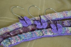 Knitted covered hangers with crochet butterfly motif