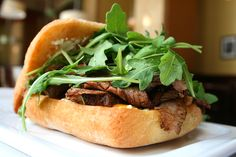 #LunchSpecial:  Tri-tip sandwich with pepperoncini gribiche, arugula, 12 hour tomato, cheddar cheese, and homemade steak sauce on ciabatta bread!