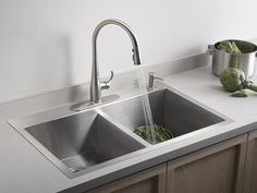 Self-Rimming Sinks: Tried and True  Available in stainless steel, porcelain and enameled cast iron, self-rimming or drop-in sinks are the most popular type of sink and the easiest to install. The sink's weight is supported by a rim that extends above the countertop surface. Durable, affordable and easy to clean, stainless steel is the most popular material for kitchen sinks. Image courtesy of Kohler Co.