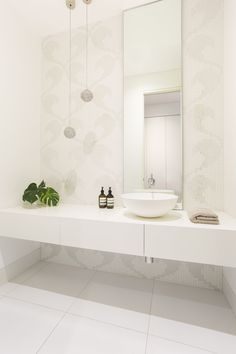 Powder room design by Biasol with apaiser basin