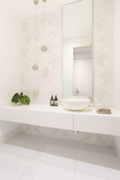 Powder room design by Biasol with apaiser basin
