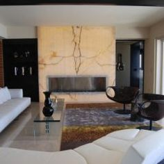 Book matched Onyx slabs make a great focal point for a fireplace wall!