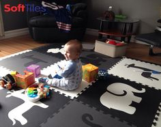 """Our Safari Animal tiles are a hit. Thanks so much!""- Terri  This play mat is the Black, Gray, and White set of Safari Animals foam mats with borders. See all our sets- http://www.softtiles.com/index.php?option=com_virtuemart&Itemid=138"