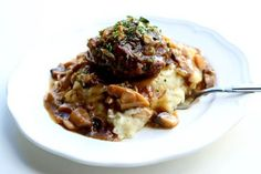 Instant Pot Salisbury Steak, Gravy and Mashed Potatoes--good old fashioned salisbury steak is prepared in your pressure cooker with a savory mushroom and onion gravy and creamy mashed potatoes. An amazing homemade one pot meal that will have you throwing away any TV dinners that you have in your freezer.