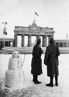 Two West Berlin policemen on duty with new American rapid fire rifles (and a snowman). Christmas Day, the Berlin Wall at the Brandenburg Gate, December East Germany, Berlin Germany, Berlin Christmas, Berlin Hauptstadt, Snowman Photos, Rifles, Fine Art Prints, Canvas Prints, Framed Prints