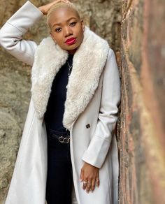 The Eve Coat is the perfect outer layer for winter. With its sophisticated longline silhouette, this coat will keep you cosy without compromising on style. Beautiful Mmabatho adds a red lip to create a show-stopping look. Long A Line, Red Lips, Cosy, Eve, Fur Coat, Layers, Silhouette, Luxury, Create