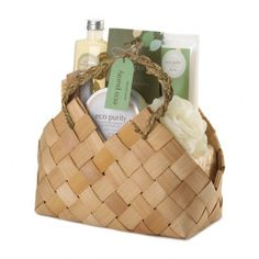 """#10016920 GREEN TEA AND BERGAMOT SPA SET Description: Gorgeous scent, gorgeous basket, gorgeous gift! This spa bath set comes with essentials for a soothing soak, including tools to clean and exfoliate tired skin. The woven basket makes this set worthy of display in any bathroom.   Includes 200 ml shower gel, 110 ml body scrub, 165 ml body lotion, bath crystals, luffa sponge, wood nail brush and bamboo basket. 10.5"""" x 5.5"""" x 10.2""""  PRICE: $24.95"""