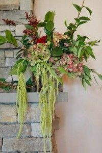 Mantel flowers in greens and antique hydrangea  Glenora Winery Weddings mantel pieces in hydrangea Tom mike photography