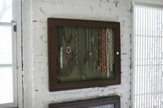 Here, shadow boxes are used to organize vintage jewelry and adorn the walls.