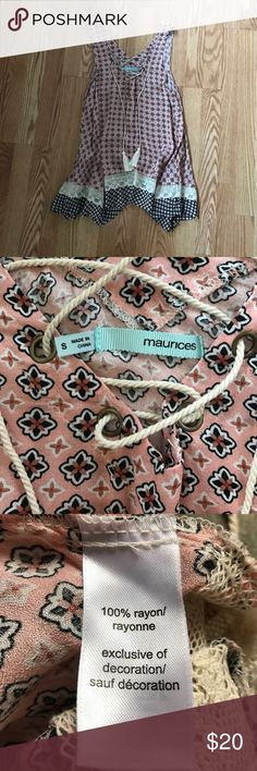Maurice's shark bite tank Maurice's shark bite tank supper cute💕 size small but is to big on me I'm usually a small in Maurice's tops by this could fit a medium. In excellent condition. Never worn! Maurices Tops Tank Tops