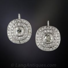 Dating from early last century, a bright white and sparkling pair of central antique cushion-cut diamonds, totaling 1.35 carats, are framed by double, stacked tiers of small scintillating antique cushion diamonds (bringing the total diamond weight to 4.00 carats), in these splashy cushion-shaped sparklers, hand fabricated in platinum with pierced galleries and a fine millegrain outline finish. Measuring 5/8 inch in each direction, they drop about 3/4 inch from the lever-back wires.