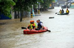 Rescuers use inflatable boats to evacuate residents from a neighborhood flooded by heavy rains from Typhoon Chan-Hom in Shaoxing in eastern China's Zhejiang province Saturday, July 11, 2015. Some 1.1 million people were evacuated from coastal areas of Zhejiang and more than 46,000 in neighboring Jiangsu province ahead of the storm, the official Xinhua News Agency reported. (Chinatopix via AP) CHINA OUT