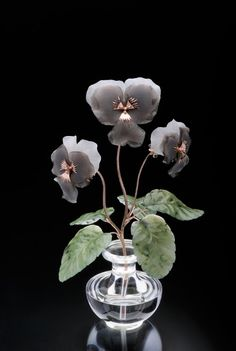 Carved Orchids from Artstone Agency.