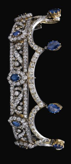 : SAPPHIRE AND DIAMOND TIARA, LATE CENTURY Designed as a series of pinnacles each surmounted by a pear shaped sapphire, the base of scroll design interspersed with oval sapphire and diamond clusters, set throughout with cushion shaped, circular and s Royal Crowns, Royal Tiaras, Tiaras And Crowns, Diamond Tiara, Diamond Cuts, Sapphire Diamond, Sapphire Jewelry, Royal Jewelry, Fine Jewelry