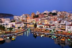 The Municipality of Agios Nikolaos, Crete, is inviting interested parties to submit proposals for the design of a new logo for the destination's tourism promotion. Crete Island Greece, Logo Design Competition, Voyage Hawaii, Crete Chania, Republic Of Venice, Romantic Escapes, Greek Islands, Travel Guide, Tourism