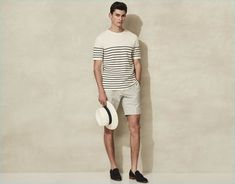 Riviera style is front and center with Reiss' Breton stripe short-sleeve sweater. The casual staple complements a Panama hat, off-white tailored shorts, and suede tasseled loafers.