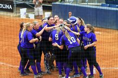 Team celebrates a homerun by senior Amber Steinhardt vs. College of Charleston at @Southern Conference Tournament. (2013)