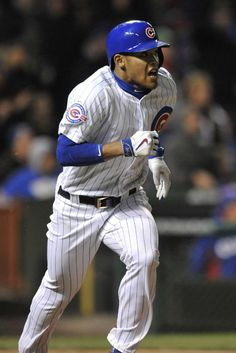 Chicago Cubs' Addison Russell watches his two RBI triple during the sixth inning of a baseball game against the Milwaukee Brewers Tuesday, April 26, 2016, in Chicago.