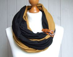 Made of two infinity scarves with leather cuff. Easy to make. I have some old closures from shoes, bags I could reuse for this.