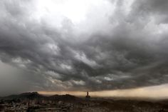 Clouds gather over the Saudi holy city of Mecca as seen from the top of Noor Mountain, Saudi Arabia. (AP)