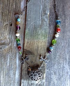 Beaded Multi-Color Medallion Necklace, Dragonflies, Red, Green, Turquoise, Purple, Pearl/A personal favorite from my Etsy shop https://www.etsy.com/listing/236242898/dragonfly-multi-color-beaded-necklace