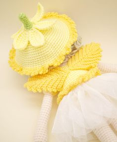 This is a finished handmade amigurumi crochet doll of a sweet Daffodil flower fairy. She wears a beautiful off white organza skirt topped with crochet petals made to look like a Daffodil flower. On her back are little light orange leaf wings and on her head of curls is a removable floral hat. Her shoes were made to match her outfit and have two little crochet leaves on each shoe for embellishment This Daffodil flower fairy was lovingly handmade with the following materials: - 100% acrylic…