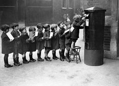 Schoolchildren posting letters in the playground of the Red Lion Street School, London, 1926