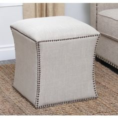 @Overstock.com - Abbyson Living Kimberly Nailhead Trim Ottoman - Give your living room or den a useful accent piece with the addition of this brass nailhead ottoman. The cream-colored ottoman fits in well with a contemporary decor, adding to the room's appearance while providing additional seating.  http://www.overstock.com/Home-Garden/Abbyson-Living-Kimberly-Nailhead-Trim-Ottoman/8133902/product.html?CID=214117 $148.99