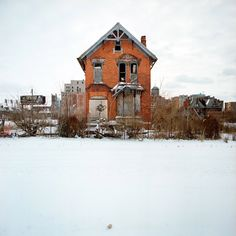 A photography series of 100 abandoned houses in Detroit, Michigan by Kevin Bauman