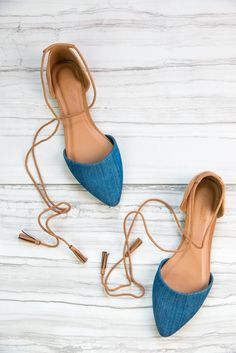 These flats are right on trend with their two tone cognac and denim coloring and wrap ankle ties with tasseled ends! We love the d'Orsay design for summer and are ready to pair these shoes with our wa