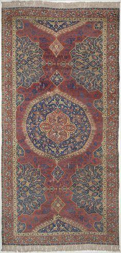 Ushak Carpet. A large rectangular carpet of symmetrical design. ca. 1500 (made).