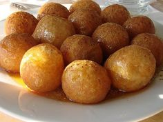 Loukoumades - Greek Honey Puffs - we get these at the International Street Fair near us, that is held every Labor Day weekend, and they are delicious. But who wants to wait a whole year for a treat you love? Churros, Greek Sweets, Greek Desserts, Greek Food Recipes, Indian Desserts, Sweet Recipes, Greek Donuts, Mini Doughnuts, Honey Puffs