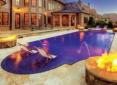 this roman shaped pool includes decorative glass tile at the waterline laminar water arcs. beautiful ideas. Home Design Ideas